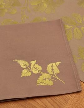 Serviette en coton pur taupe, brodée de feuilles vertes, confectionnée en France