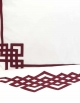 White top sheet embroidered with red ribbons